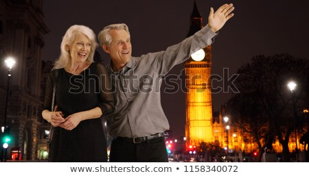 couple hailing london taxi stock photo © is2