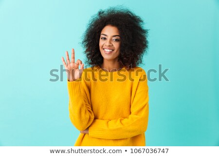 Content american woman in colorful shirt looking on camera and p Stock photo © deandrobot