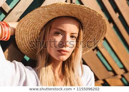 Serious woman in swimwear posing Stock photo © deandrobot