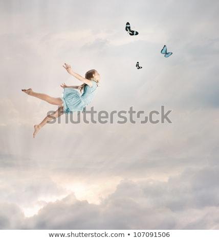 Wdzięczny mały blond dziewczyna stwarzające Motyl Zdjęcia stock © acidgrey