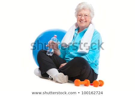 Senior woman rests and drinks water after workout Stock photo © boggy