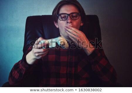 Annoiato giocare videogiochi computer seduta tavola Foto d'archivio © deandrobot