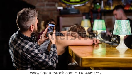 drunk man with alcohol calling on smartphone Stock photo © dolgachov