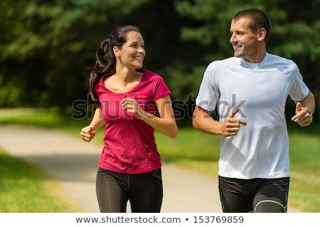 smiling couple running Stock photo © dolgachov