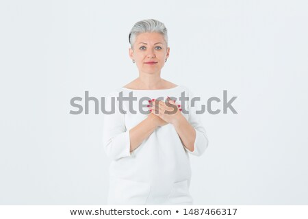 Beautiful woman holding herself chest and heart two hands Stock photo © artfotodima