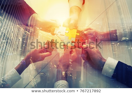 teamwork of partners concept of integration and startup with puzzle pieces stock photo © alphaspirit
