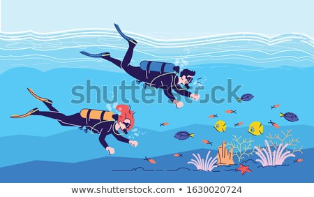 Two divers at the seaside Stock photo © colematt