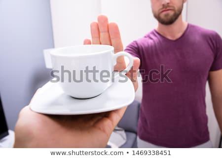 Férfi csésze kávé közelkép kéz ital Stock fotó © AndreyPopov