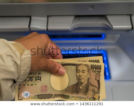 Woman's Hand Withdrawing The Cash From ATM Stock photo © AndreyPopov