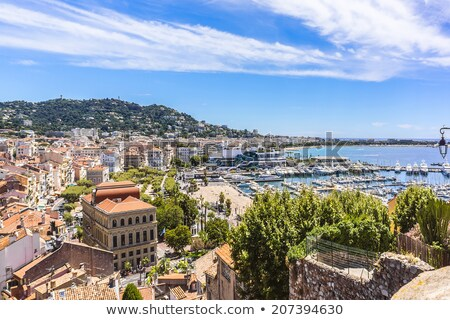Cannes. Old town of Cannes on French riviera yachting harbor eve Stock photo © xbrchx