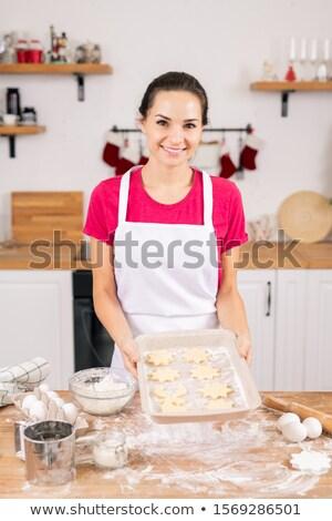 Mutlu genç ev kadını tepsi Stok fotoğraf © pressmaster