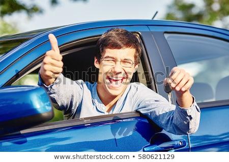 Happy student of driving school showing car keys Stock photo © Kzenon