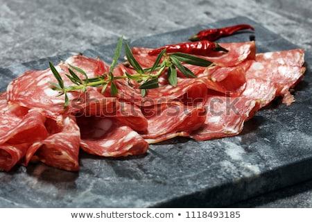Léger salami tranche fourche hongrois isolé Photo stock © Digifoodstock