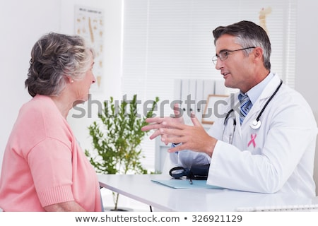 Side view of a Caucasian senior female patient talking with doctor in clinic Stock photo © wavebreak_media