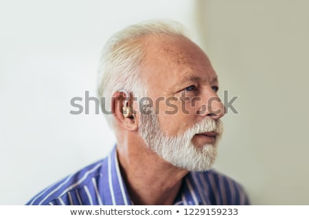 senior man wearing a hearing aid Stock photo © nito