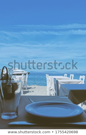 Empty restaurant by the Aegean sea and cruise boat, travel and nature Stock photo © Anneleven