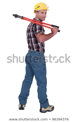 portrait of craftsman wearing jeans holding spanner stock photo © photography33