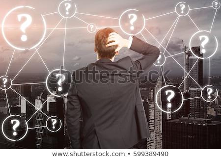 Confuso empresário gesto cara isolado branco Foto stock © kokimk
