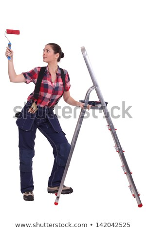 Woman with paint roller stood by ladder Stock photo © photography33
