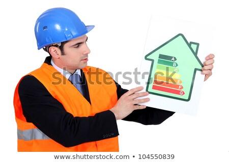 Foreman holding panel of energy consumption ranking Stock photo © photography33