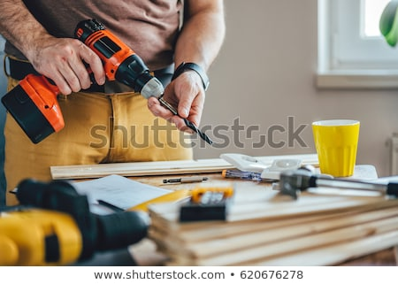 молодые · плотник · дрель · человека - Сток-фото © photography33