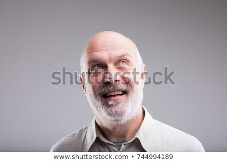 Elderly man looking up with expectant look Stock photo © jarenwicklund