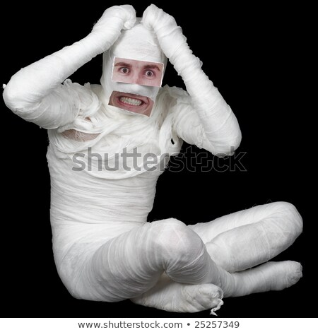 man in bandage with false eyes and mouth stock photo © pzaxe