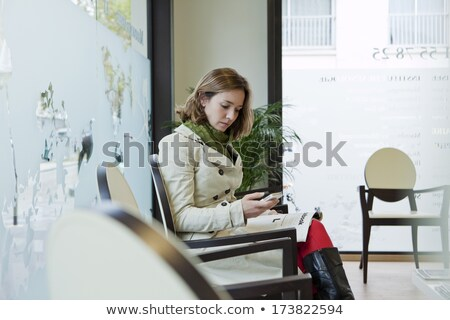 Woman phoning in the waiting room Stock photo © photography33
