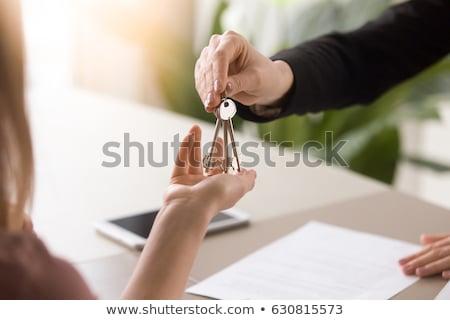 Estate-agent handing over keys Stock photo © photography33