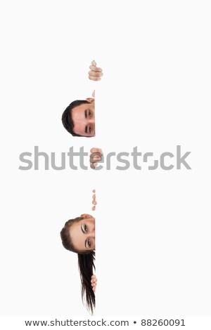 Jeunes regarder autour coin blanche Photo stock © wavebreak_media