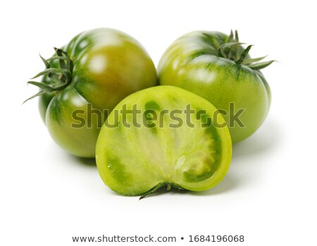 green tomato on white stock photo © gabes1976