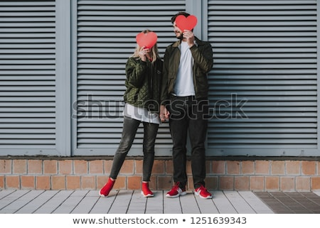 young woman and man hiding behind the door Stock photo © photography33