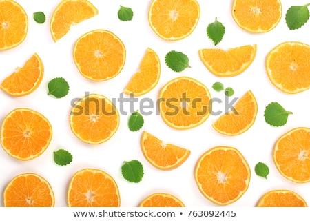 Frescos rodaja de naranja hojas menta aislado blanco Foto stock © tetkoren