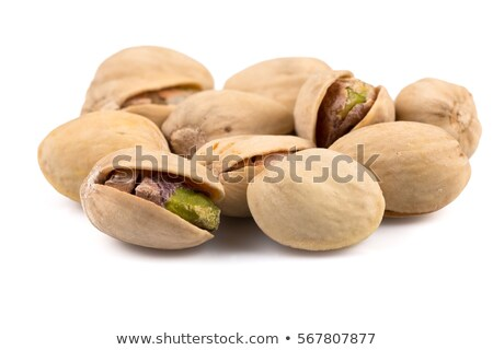 Salty nuts of roasted pistachio on isolated background Stock photo © Kirill_M