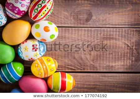 The wooden background decorated Easter eggs. Stock photo © justinb