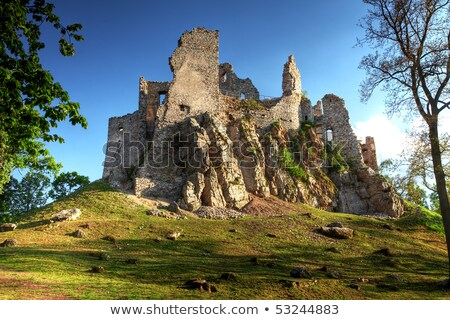 Ruins of a Castle with Mountains and Village in Background Stock photo © Kayco