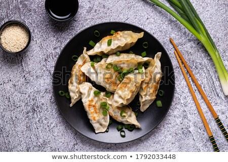 asian appetizer pan fried dumplings stock photo © szefei
