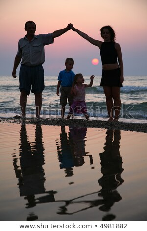 mother with children and grandfather ashore on sunset stock photo © paha_l