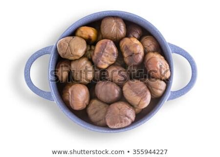 Earthenware bowl of fresh roasted chestnuts Stock photo © ozgur