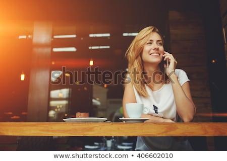 ストックフォト: 幸せ · 若い女性 · 話し · 携帯電話 · 白