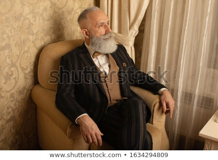 mature man in leather jacket resting stock photo © feedough