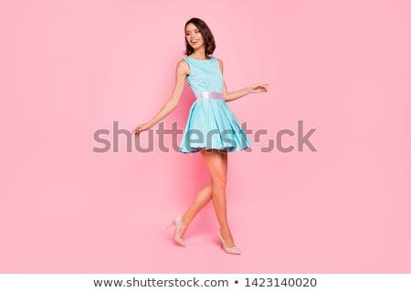 Kadın mavi elbise tam uzunlukta portre bakıyor Stok fotoğraf © filipw