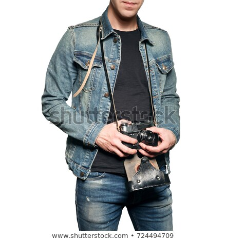 happy handsome young man with old vintage photo camera stock photo © deandrobot