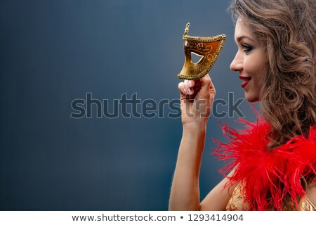 Gorgeous woman in masquerade mask Stock photo © artfotodima