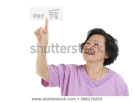 portret · glimlachend · oude · vrouw · wijzend · vinger · geïsoleerd - stockfoto © szefei