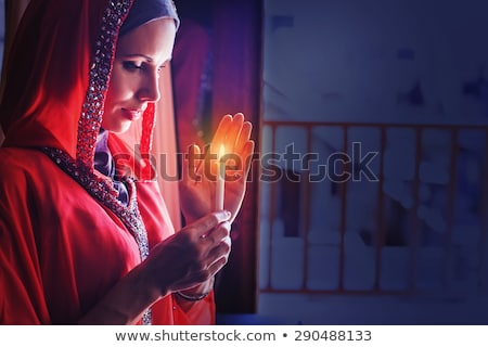 woman with cadles in the mosque Stock photo © adrenalina