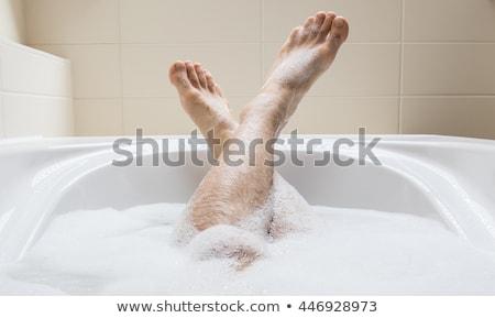 Men's feet in a bathtub, selective focus Stock photo © michaklootwijk