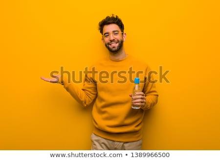Heureux homme quelque chose imaginaire main Photo stock © dolgachov