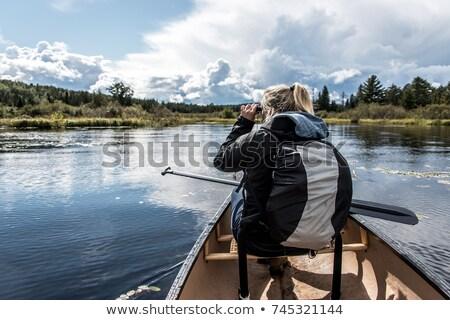girl using binocular to view mountains Stock photo © IS2