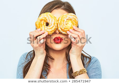 two young women eating cake stock photo © is2